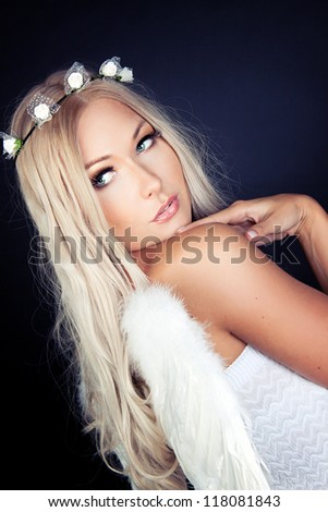 Portrait of a blonde in Angel costume - stock photo