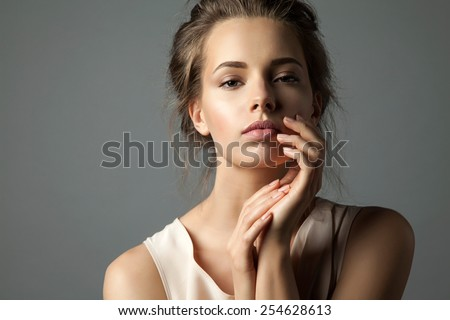 Portrait of a blonde young pretty woman with natural make-up - stock photo