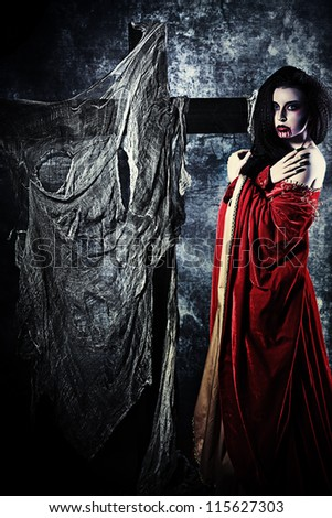 Portrait of a bloodthirsty female vampire. - stock photo