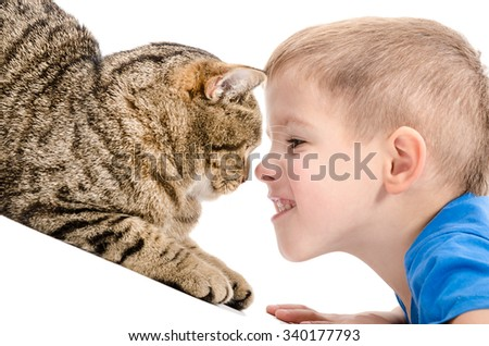 Portrait of a boy and a cat closeup isolated on white background - stock photo