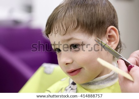 Portrait of a boy at the barbershop - stock photo