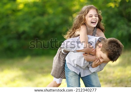 Portrait of a boy girl in a summer  - stock photo