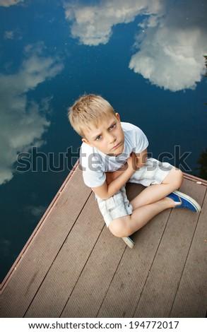 portrait of a boy in cloud - stock photo