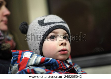 Portrait of a boy in the bus at night - stock photo