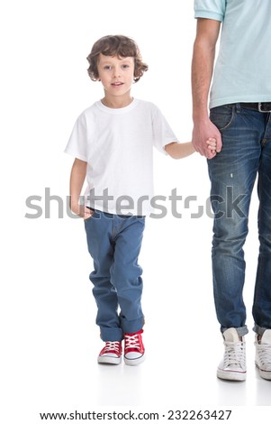 Portrait of a boy is holding a hand of father on the white background. - stock photo