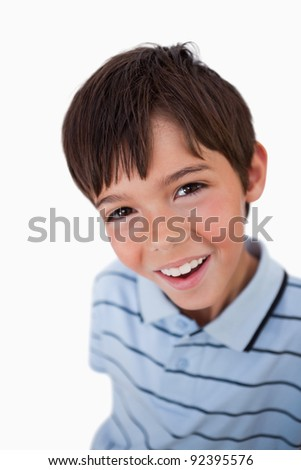Portrait of a boy looking at the camera against a white background - stock photo