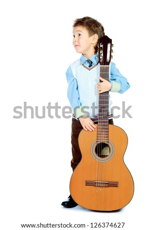 Portrait of a boy posing with his guitar. Isolated over white background. - stock photo