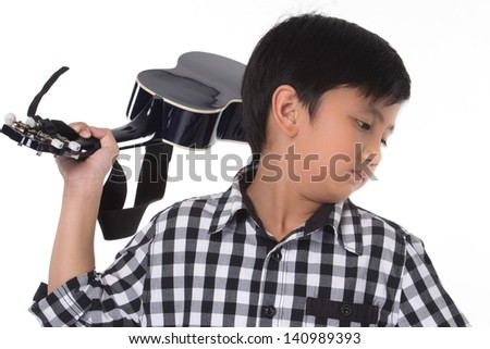 Portrait of a boy with guitar - stock photo
