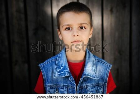 portrait of a boy with sad eyes - stock photo