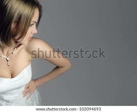 portrait of a bride in white dress - stock photo