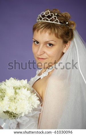 Portrait of a bride with a bouquet of white flowers - stock photo