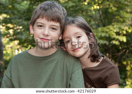Portrait of a Brother and Sister in a Natural Setting - stock photo