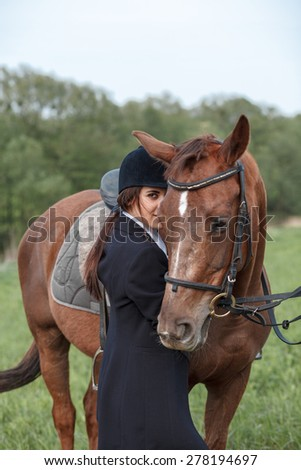 Portrait of a brown horse and woman - stock photo