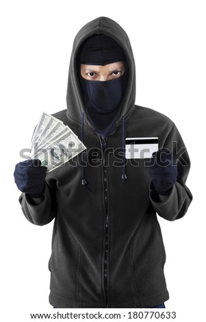 Portrait of a burglar with credit card and money on his hand - stock photo