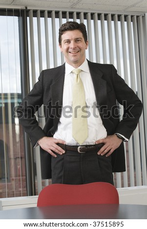 Portrait of a business man smiling. - stock photo