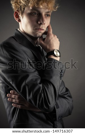 Portrait of a business man which strongly pondered on the problem - stock photo