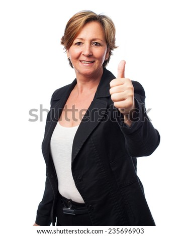 portrait of a business mature woman with thumb up - stock photo