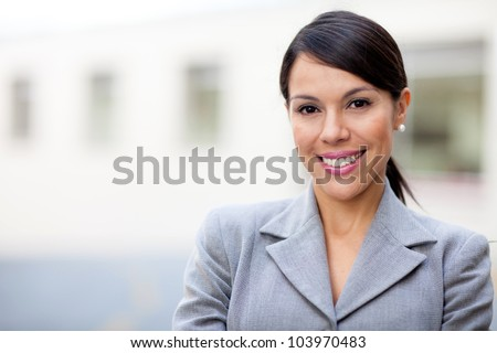 Portrait of a business woman looking happy and smiling - stock photo