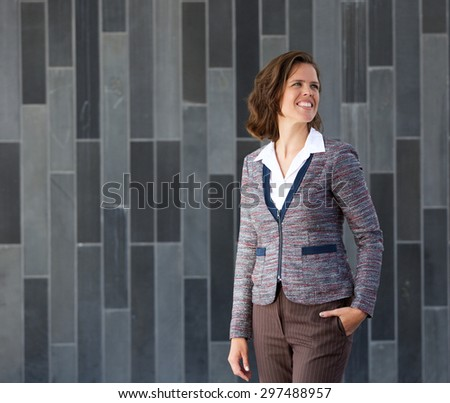 Portrait of a business woman smiling and walking  - stock photo