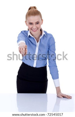 Portrait of a business woman standing at her desk and pointing forward, isolated - stock photo