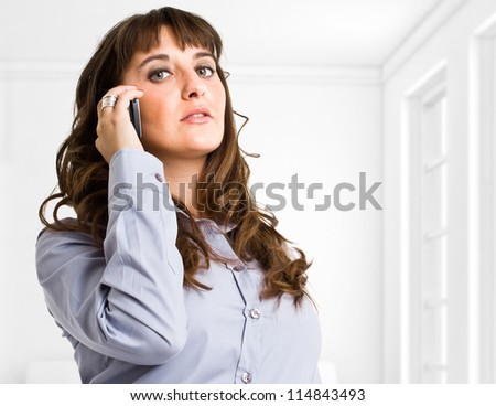 Portrait of a business woman talking on the phone - stock photo