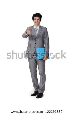 Portrait of a businessman giving the thumb's up - stock photo