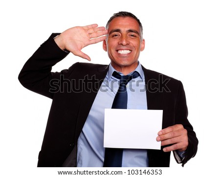 Portrait of a businessman greeting, laughing and holding a white card with copyspace against white background - stock photo