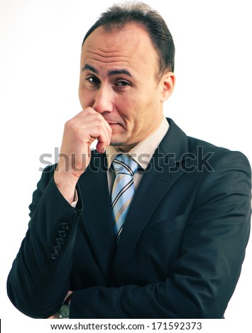 Portrait of a businessman in a suit looks incredulous ,l age thirty-five, thirty-seven years - stock photo