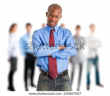 Portrait of a businessman in front of a group of people - stock photo
