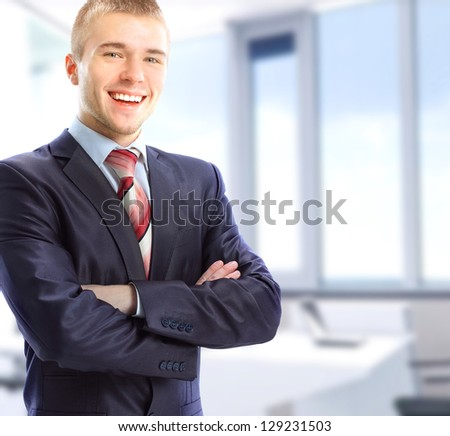 Portrait of a businessman in his office - stock photo