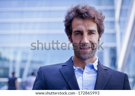 Portrait of a businessman looking at the camera - stock photo