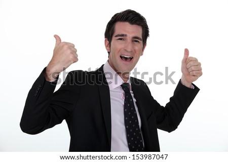 Portrait of a businessman rejoicing - stock photo