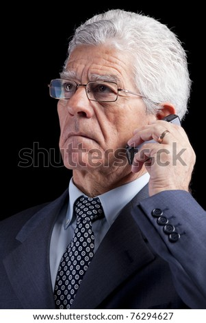 Portrait of a businessman talking at the mobile phone  (isolated on black) - stock photo