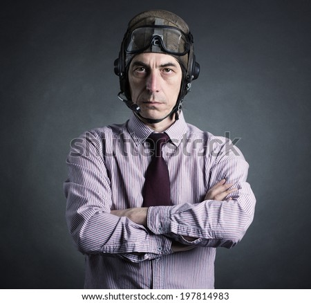 Portrait of a businessman wearing a helmet aviator. - stock photo