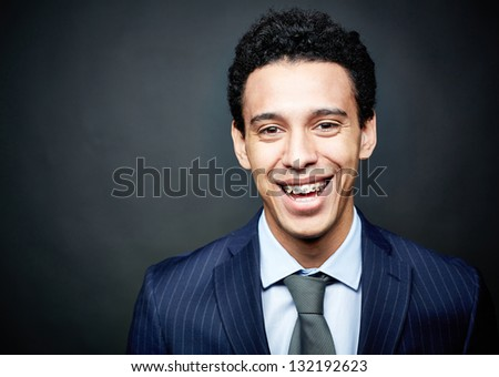 Portrait of a businessman wearing braces and smiling confidently - stock photo