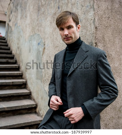 Portrait of a businessman who is focused and looking away against a  wall, close-up  - stock photo