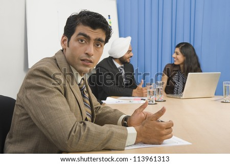 Portrait of a businessman with his colleague in a board room - stock photo