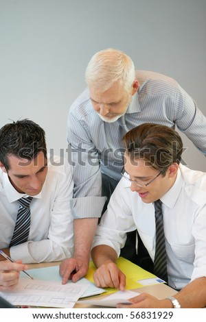 Portrait of a businessmen in suit watching documents - stock photo