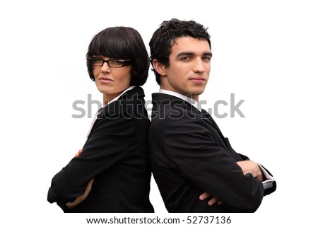 Portrait of a businesswoman and a businessman back to back - stock photo