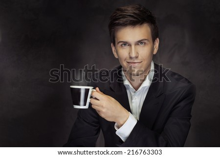 portrait of a businesswoman drinking coffee - stock photo