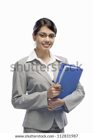 Portrait of a businesswoman holding a file and standing against a white background - stock photo