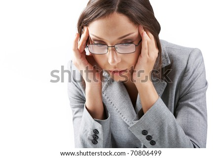 Portrait of a businesswoman in glasses rubbing her temples - stock photo