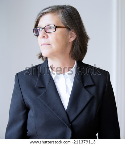 Portrait of a businesswoman looking to the side - stock photo