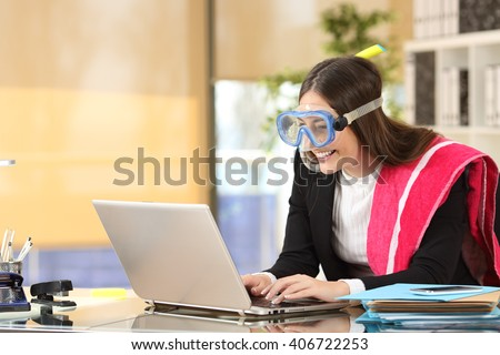 Portrait of a businesswoman needing vacation booking hotel or sending mails on line with a laptop at job - stock photo