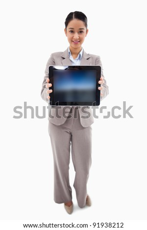 Portrait of a businesswoman showing a tablet computer against a white background - stock photo