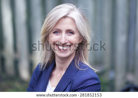 Portrait Of A Businesswoman Smiling At The Camera - stock photo