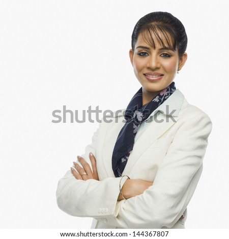Portrait of a businesswoman with arms crossed - stock photo