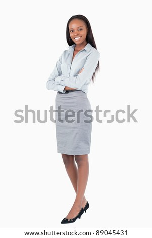 Portrait of a businesswoman with the arms crossed against a white background - stock photo