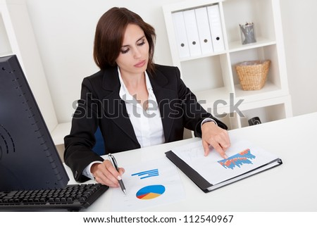 Portrait of a businesswoman working in office - stock photo