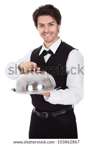 Portrait of a butler with bow tie and tray. Isolated on white - stock photo